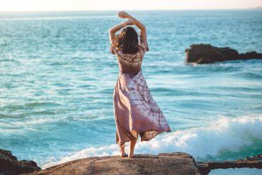 girl standing ocean