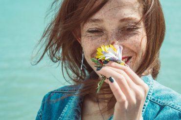 woman freckles flower
