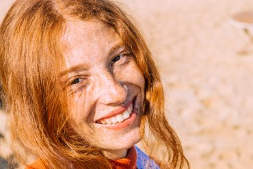 woman smiling freckles